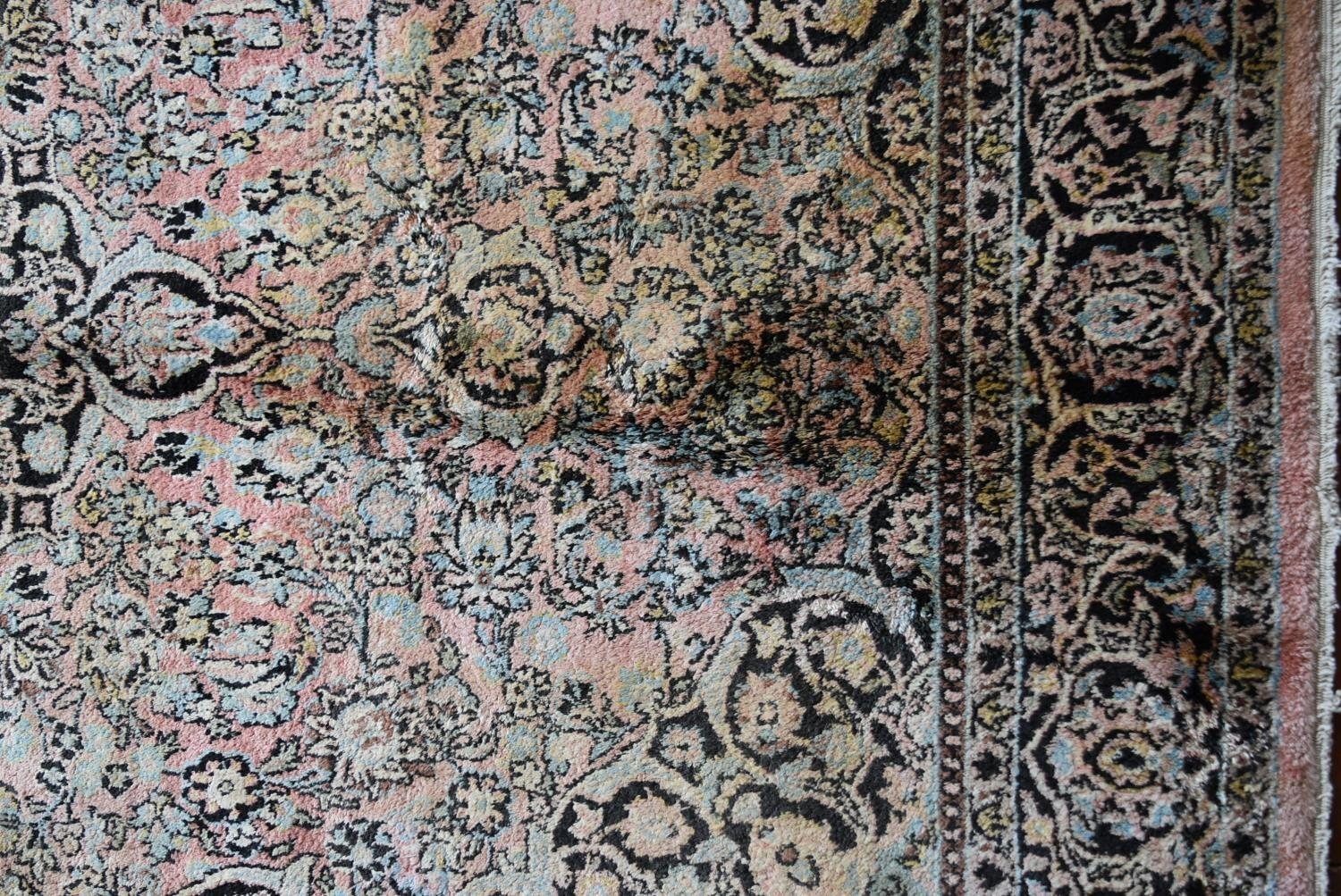 A silk Kashmir rug with central pendant medallion and scrolling floral design on a pale pink - Image 3 of 5