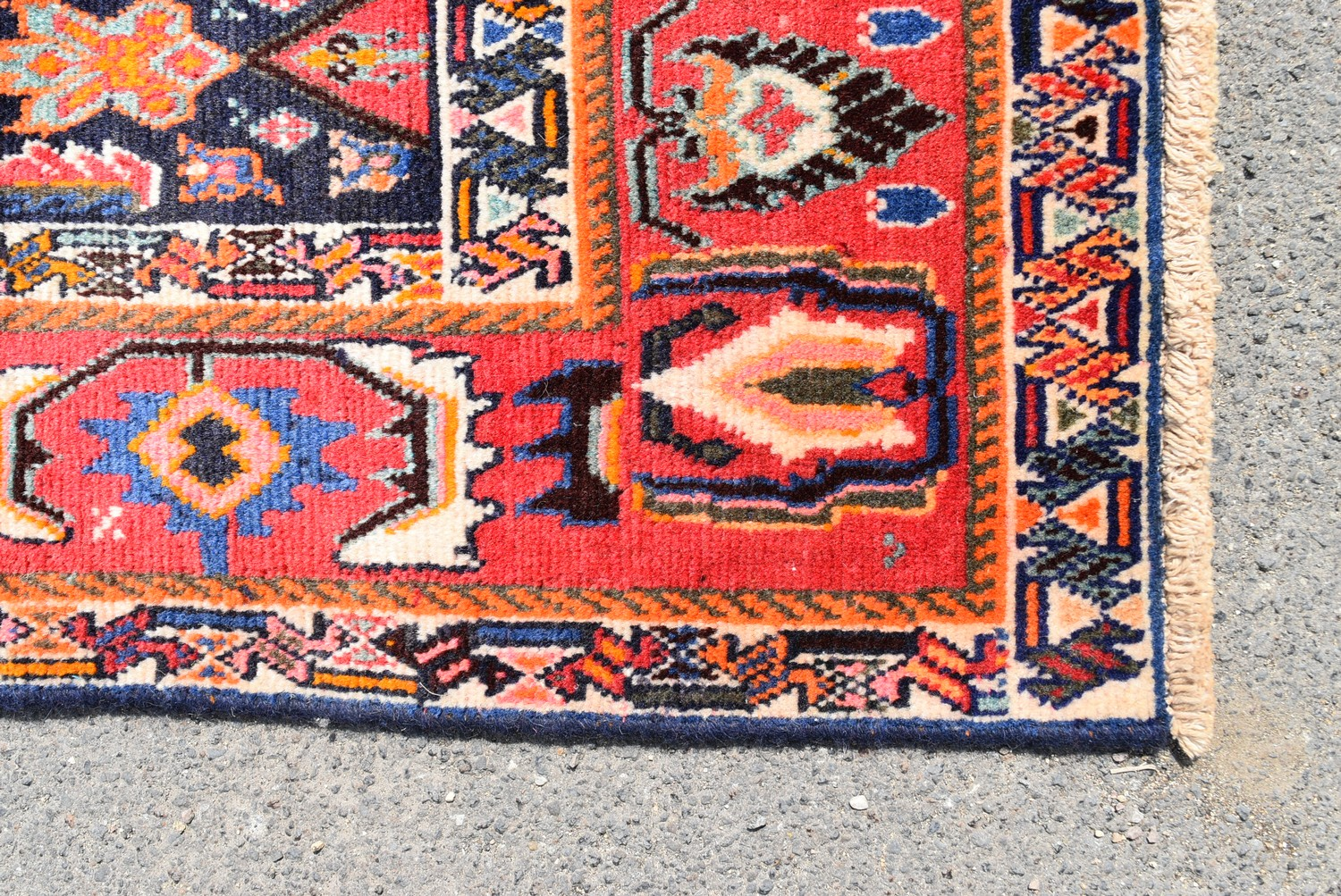 A Persian Kashkai rug with triple hooked medallions on a midnight ground within a stylised multi - Image 3 of 4