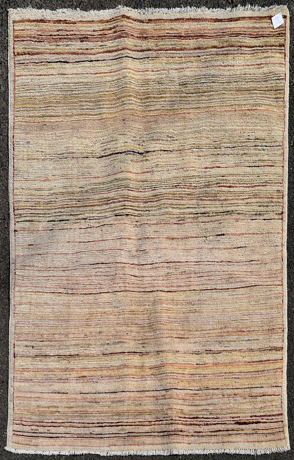 A modern rug with cross weave in hues of red and beige L.140xW.100cm