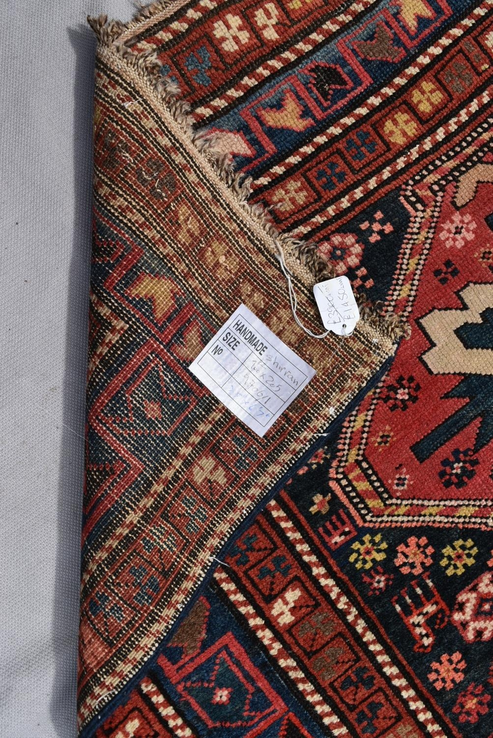 An antique Kazak rug with repeating central medallions and flowerhead and animal motifs contained - Image 4 of 5