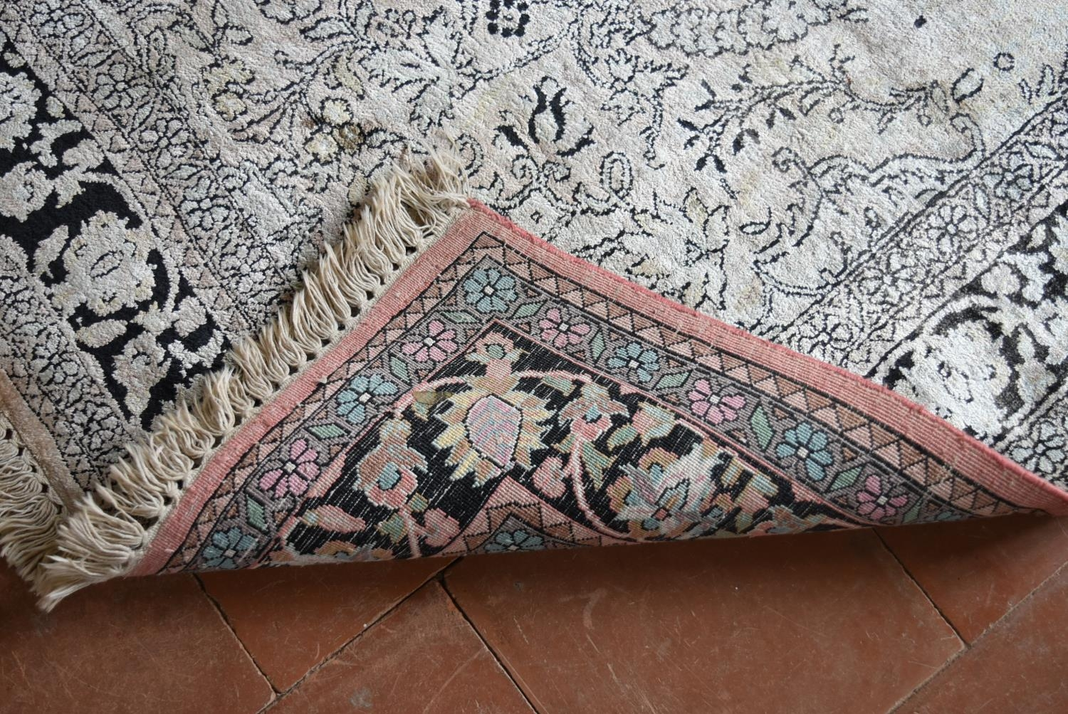 A Kashmir silk rug with all over scrolling floral design contained by foliate multi borders. L. - Image 5 of 5