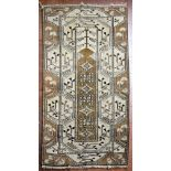 A Turkish Milas rug with central panel on fawn ground with stylised foliate design within