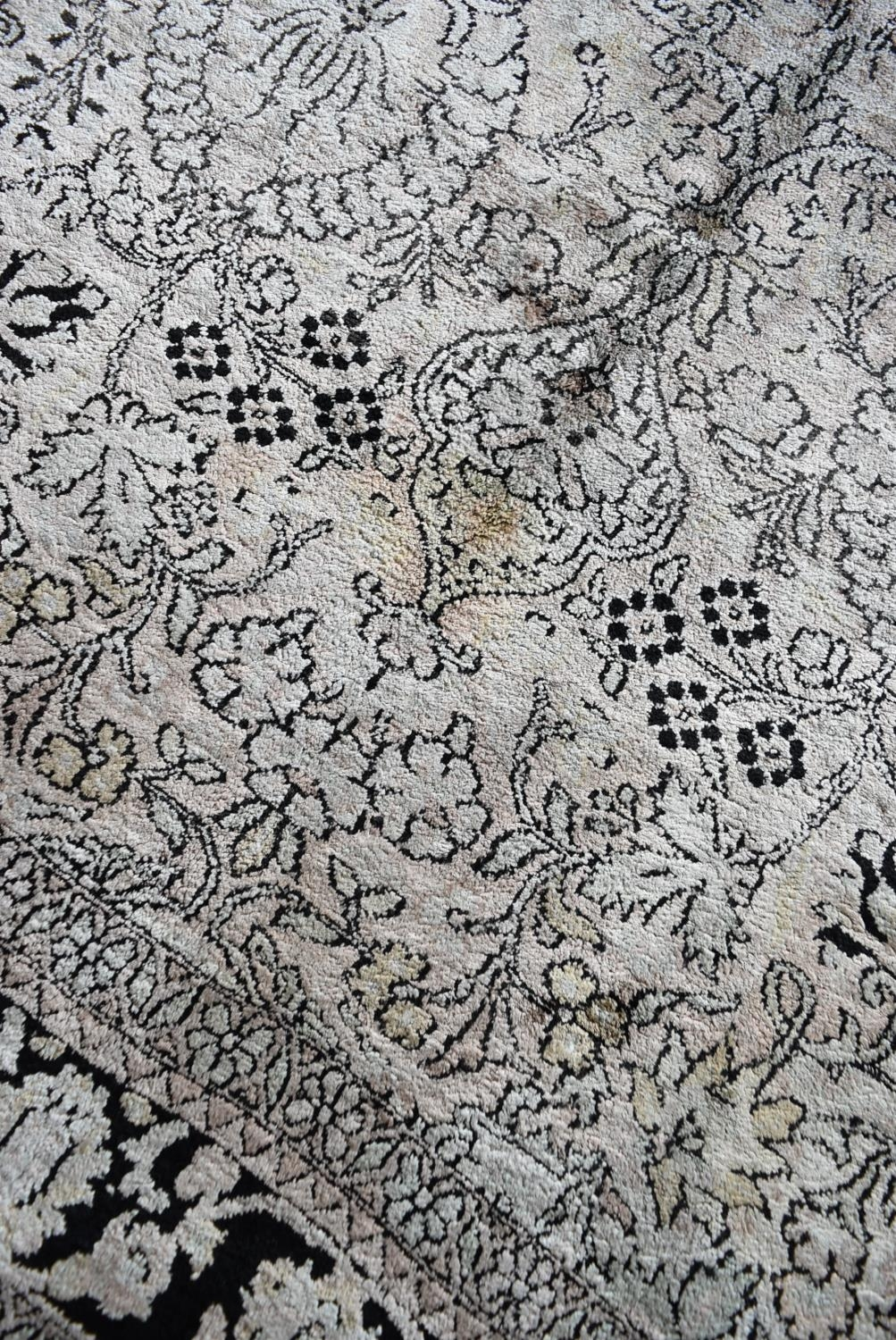 A Kashmir silk rug with all over scrolling floral design contained by foliate multi borders. L. - Image 4 of 5