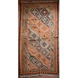 A Persian Kashkai Kilim with repeating diamond motifs in geometric multi borders. L.260xW.140cm