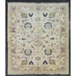 A fine Ziegler style carpet with repeating lotus flower, palmette and serrated palm decoration on