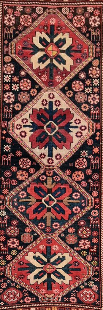 An antique Kazak rug with repeating central medallions and flowerhead and animal motifs contained - Image 2 of 5