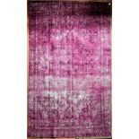 A Persian style re-dyed distressed effect carpet. L.318xW.210cm