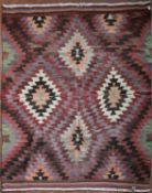 A Turkish Kilim with allover repeating diamond pattern. L.206xW.170cm