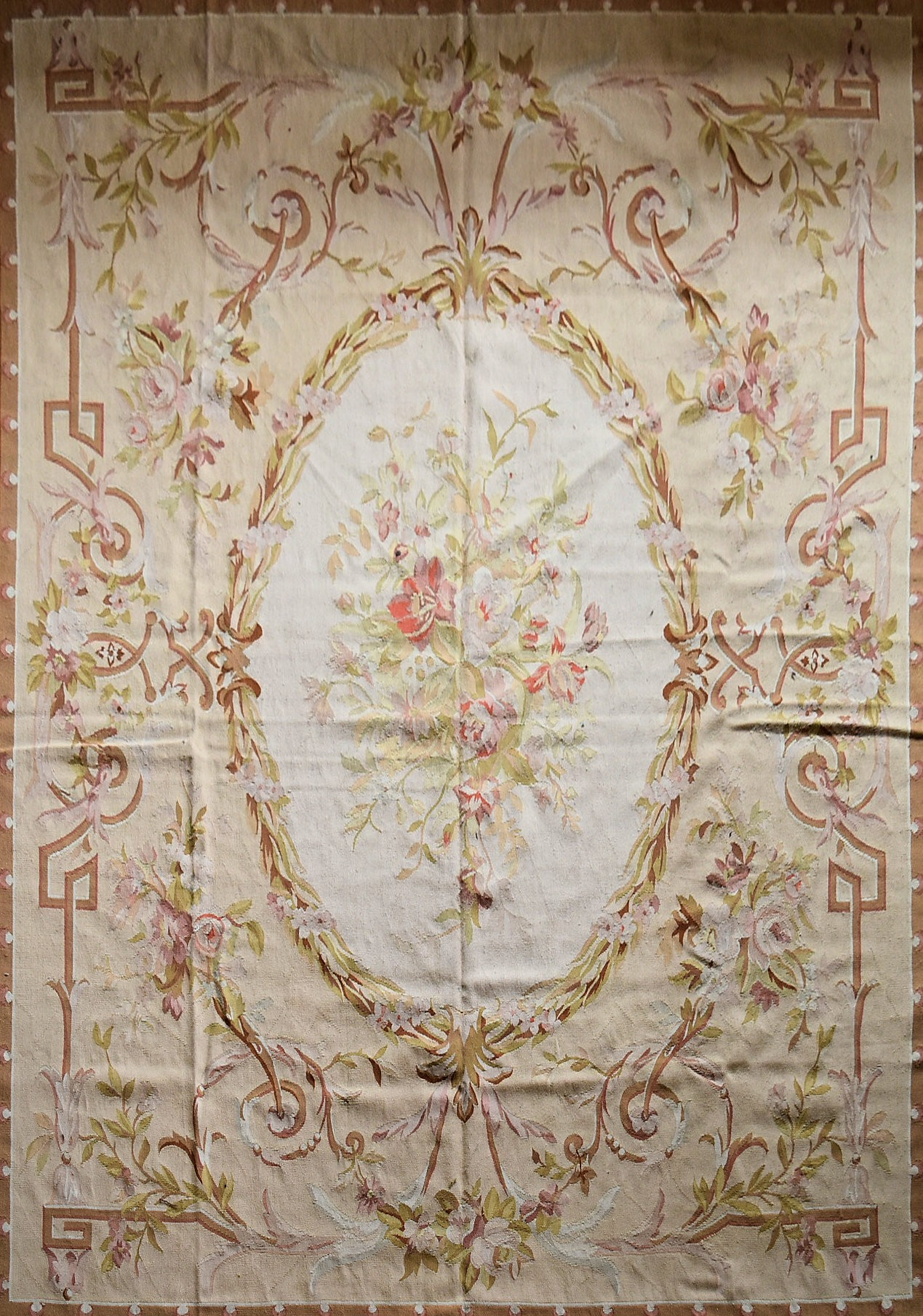 A hand made Aubusson carpet with central oval medallion with floral bouquet on a scrolling foliate - Image 2 of 4