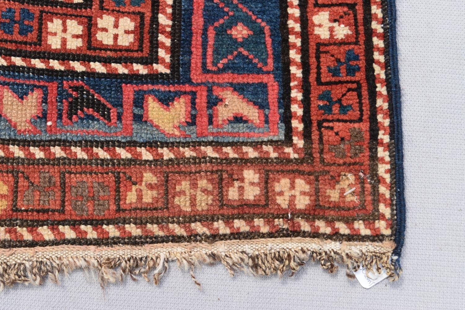 An antique Kazak rug with repeating central medallions and flowerhead and animal motifs contained - Image 3 of 5