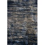 A hand tufted bamboo silk rug with abstract stylised design on an enamel blue ground. L.230xW.160