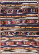 A Moroccan Kilim with multiple polychrome bands. L.195xW.140cm