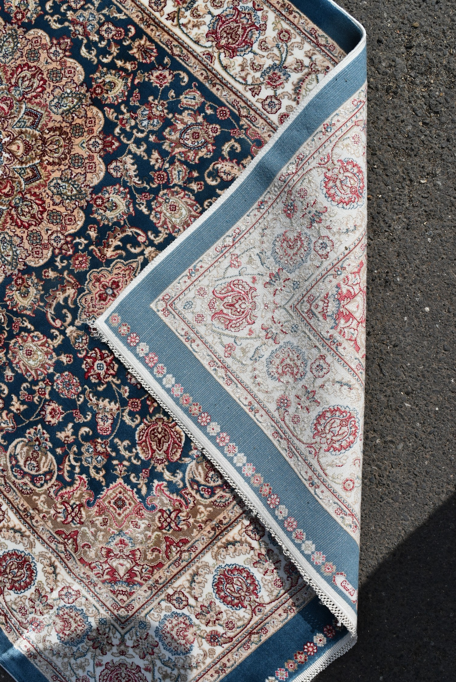A Persian style rug with central floral medallion on a sapphire ground contained by naturalistic - Image 4 of 4