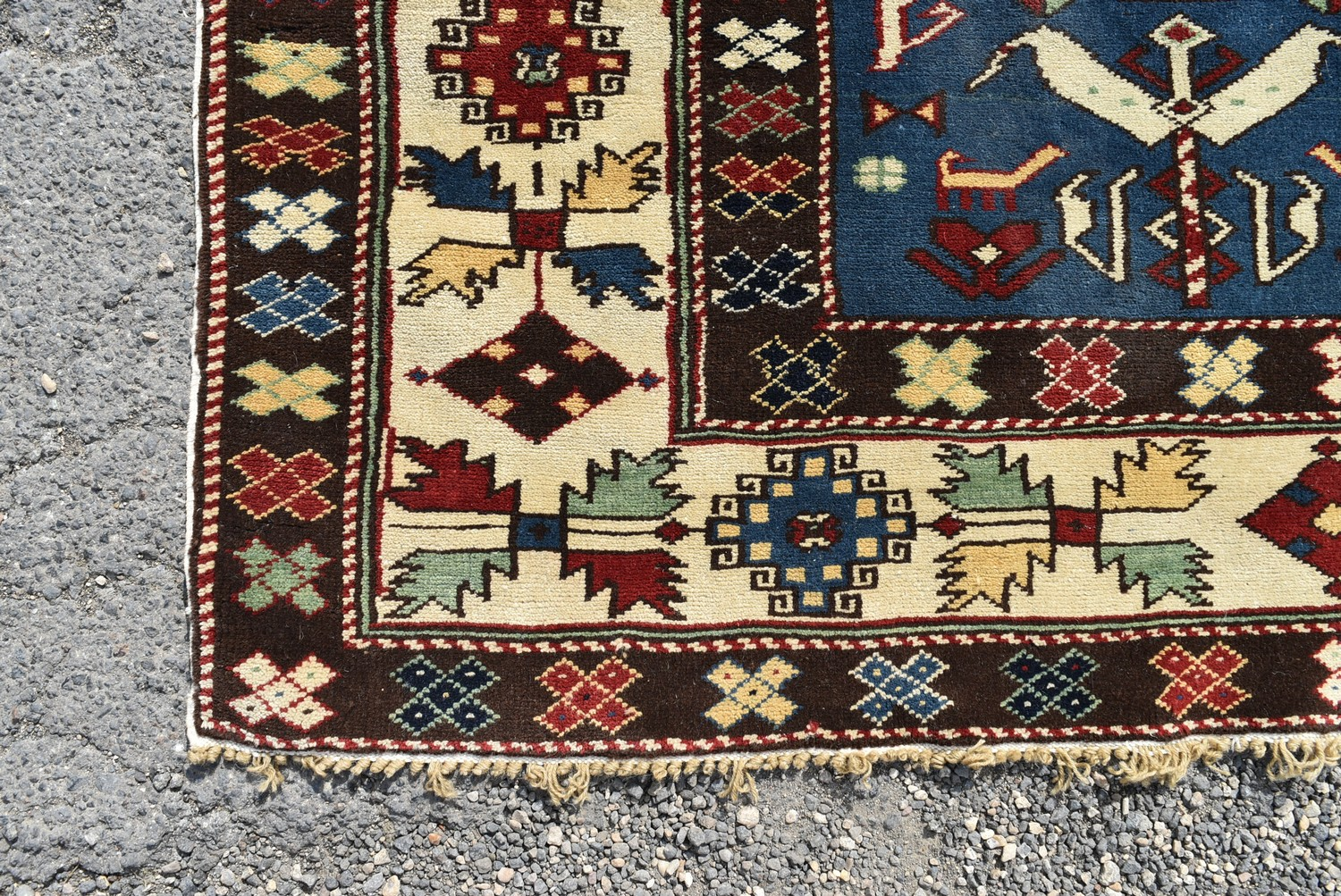 A Kazak style runner with repeating serrated palmette motifs on a sapphire ground contained by - Image 3 of 4