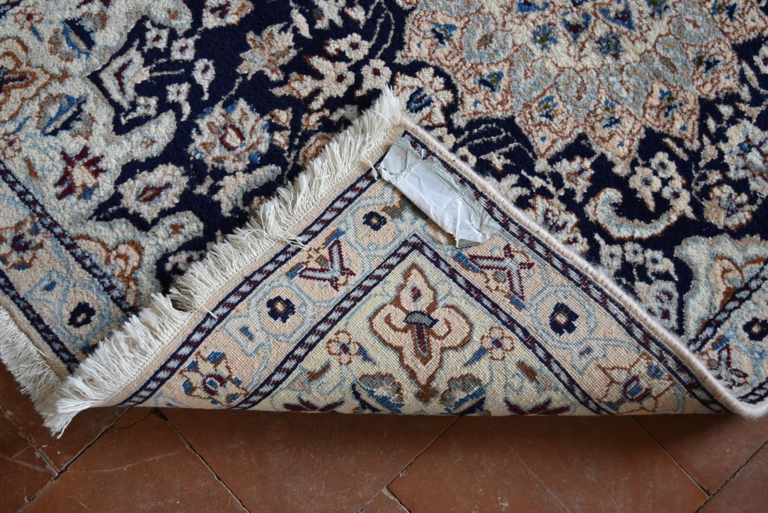 A Persian silk & wool Naiin rug with central floral medallion on a midnight ground within floral - Image 4 of 4
