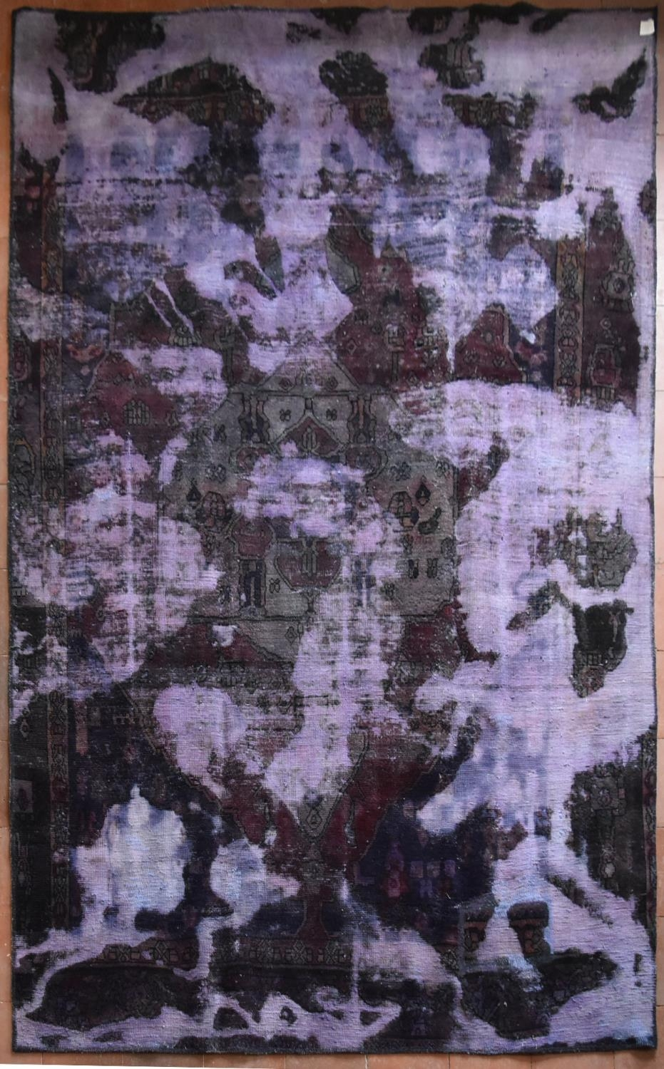 A Persian style re-dyed carpet, all over floral pattern, distressed effect. L.278xW.185cm