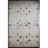 A Moroccan style rug with repeating stylised star pattern within a geometric design across the