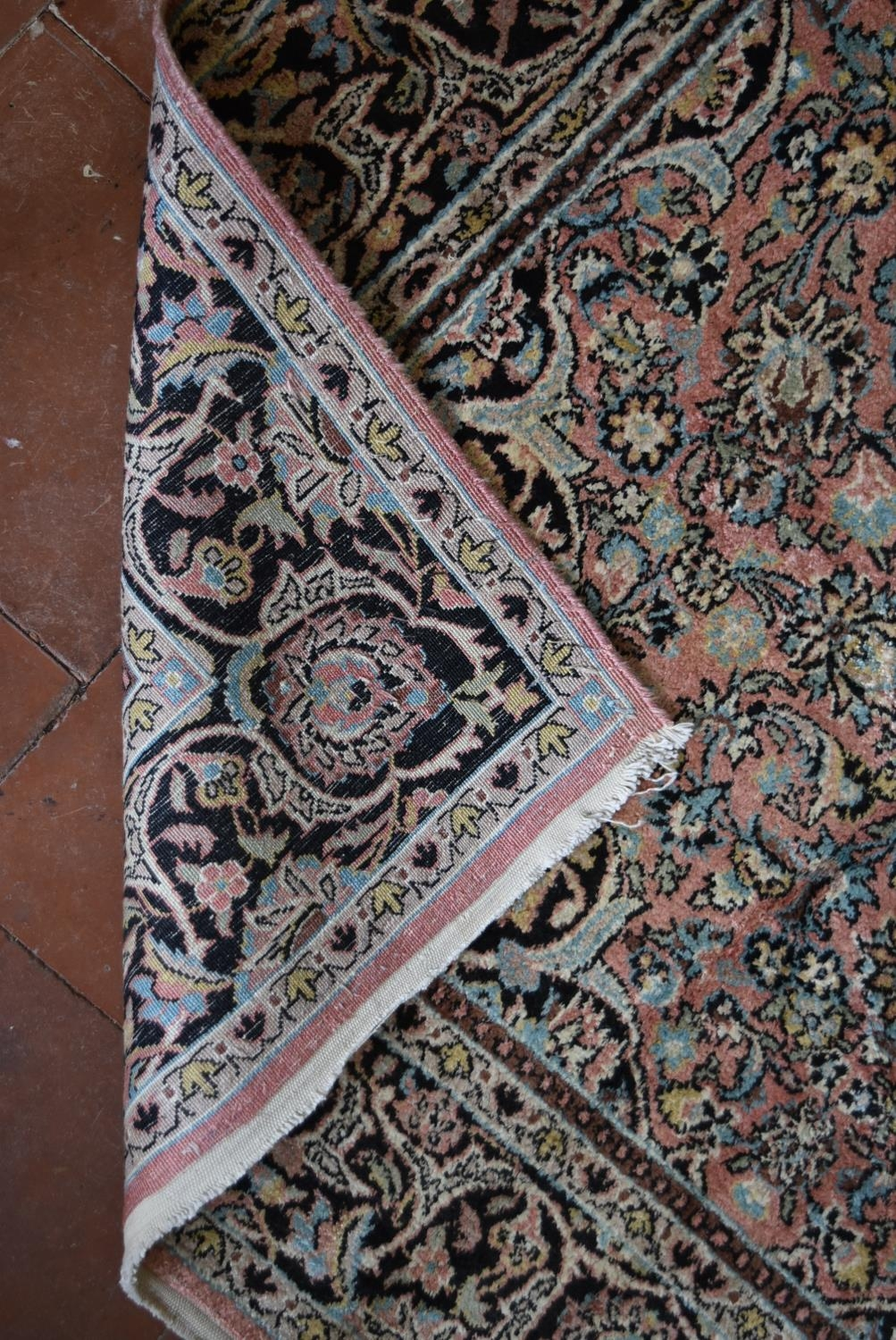 A silk Kashmir rug with central pendant medallion and scrolling floral design on a pale pink - Image 5 of 5