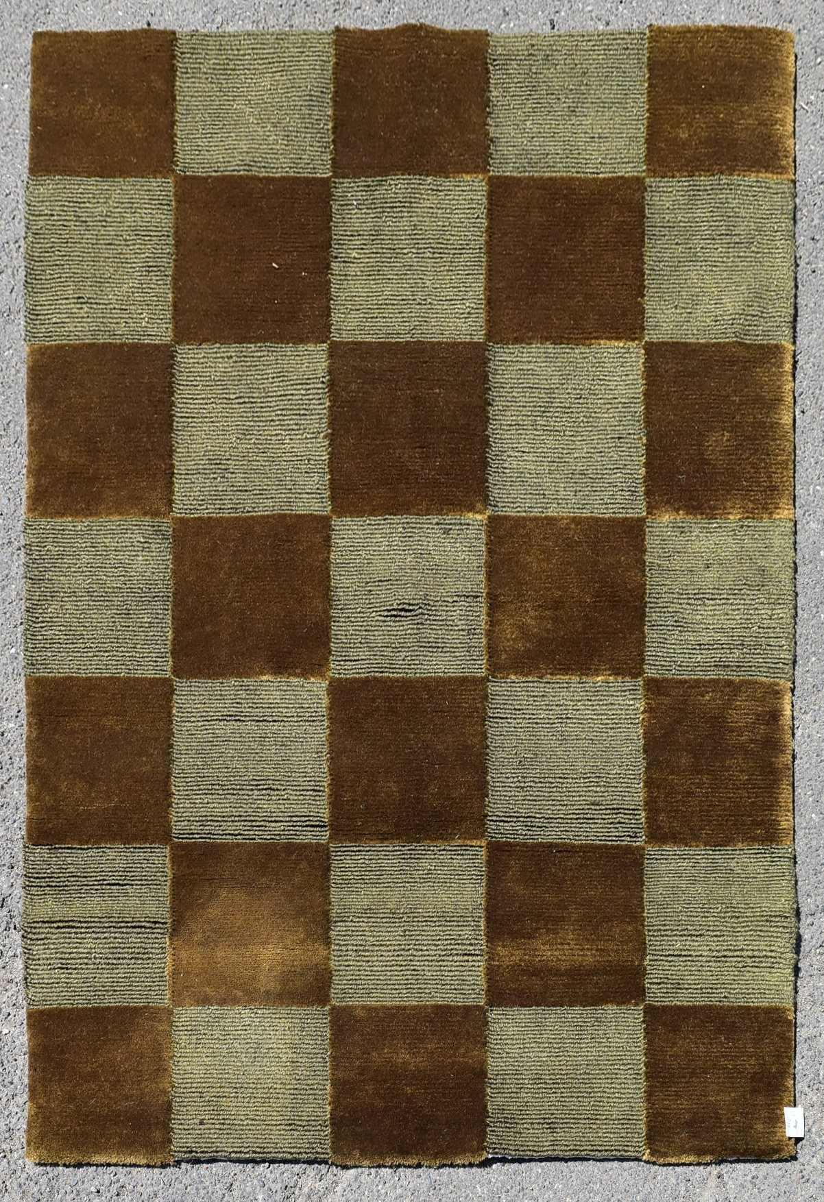 A contemporary silk & wool rug with bronze and silver chequerboard pattern. L.123xW.93cm