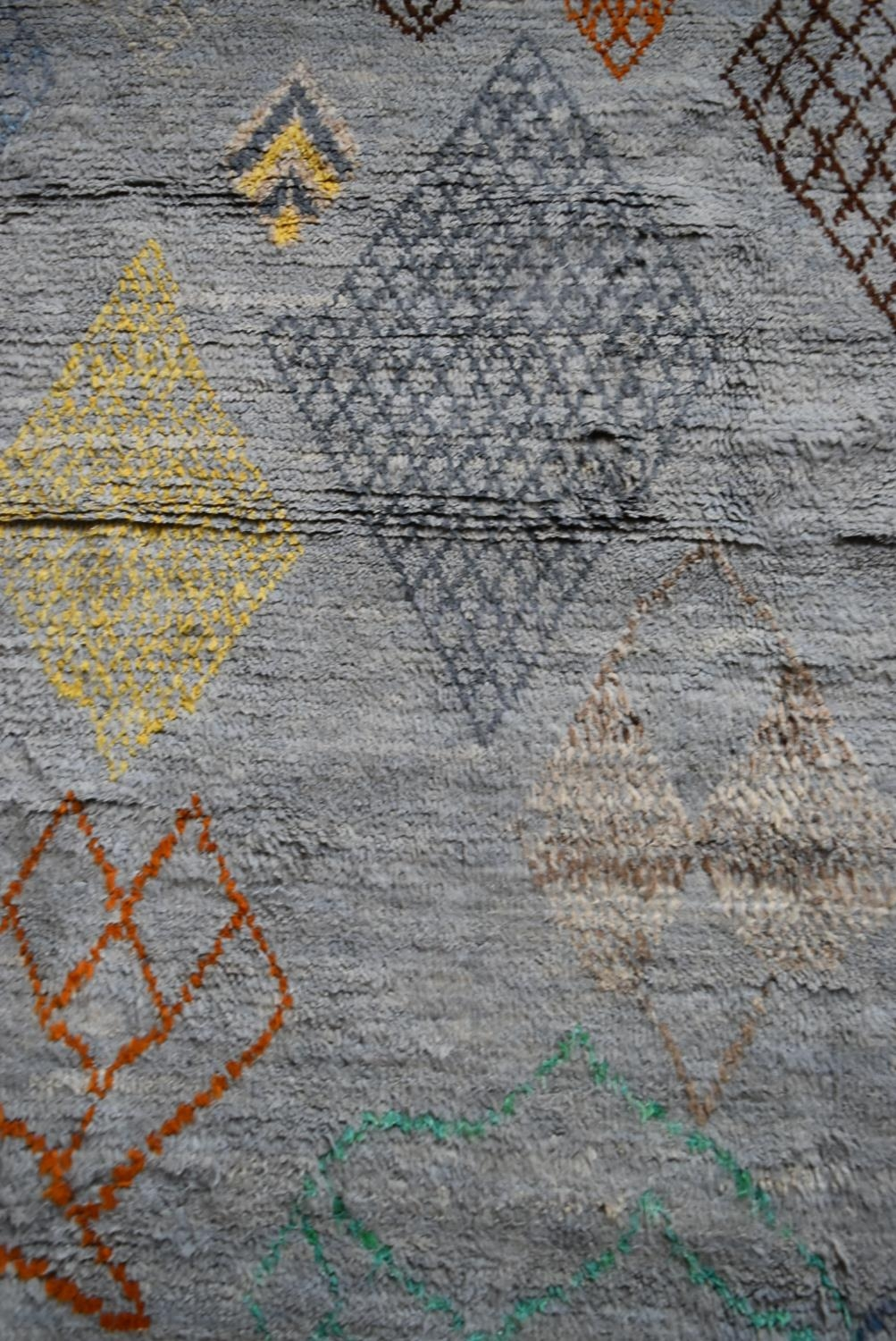 A Moroccan style rug with abstract diamond patterns across a powder blue ground. L.245xW.170cm - Image 2 of 4