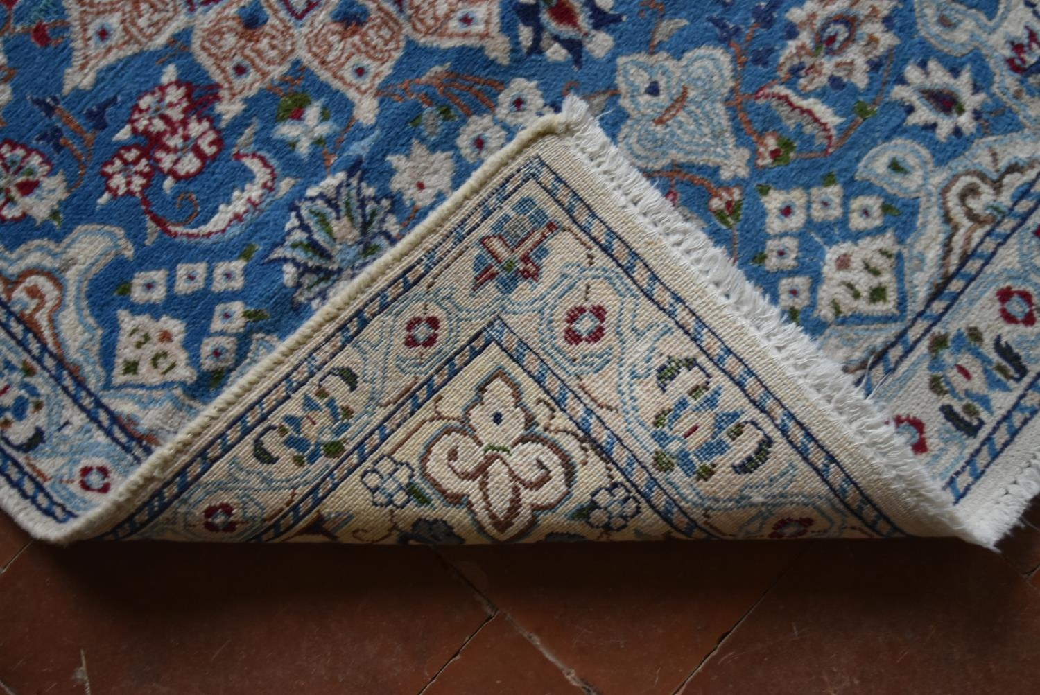 A Persian silk & wool Naiin style rug with central medallion on pale blue ground contained by a - Image 4 of 4