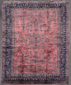 A Persian Sarogh style carpet with meandering vine, lotus flower and palmette decoration across