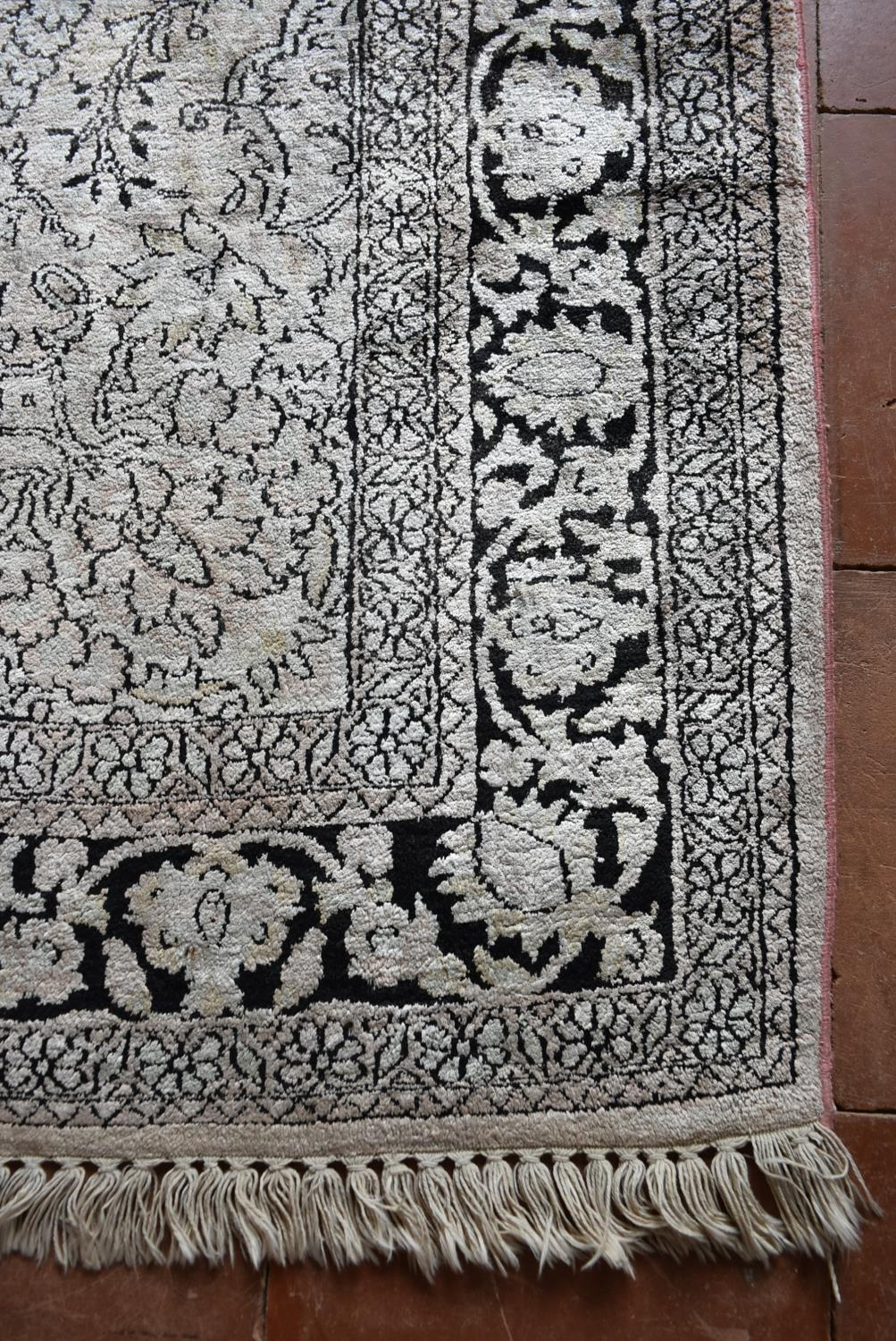 A Kashmir silk rug with all over scrolling floral design contained by foliate multi borders. L. - Image 3 of 5
