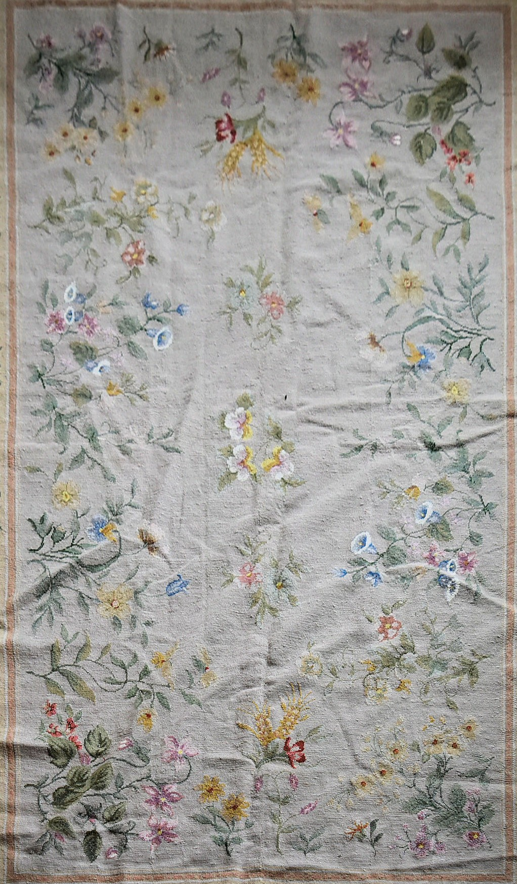 A needlepoint rug with foliate and wild flower sprays across a fawn field contained by garlands of - Image 2 of 4