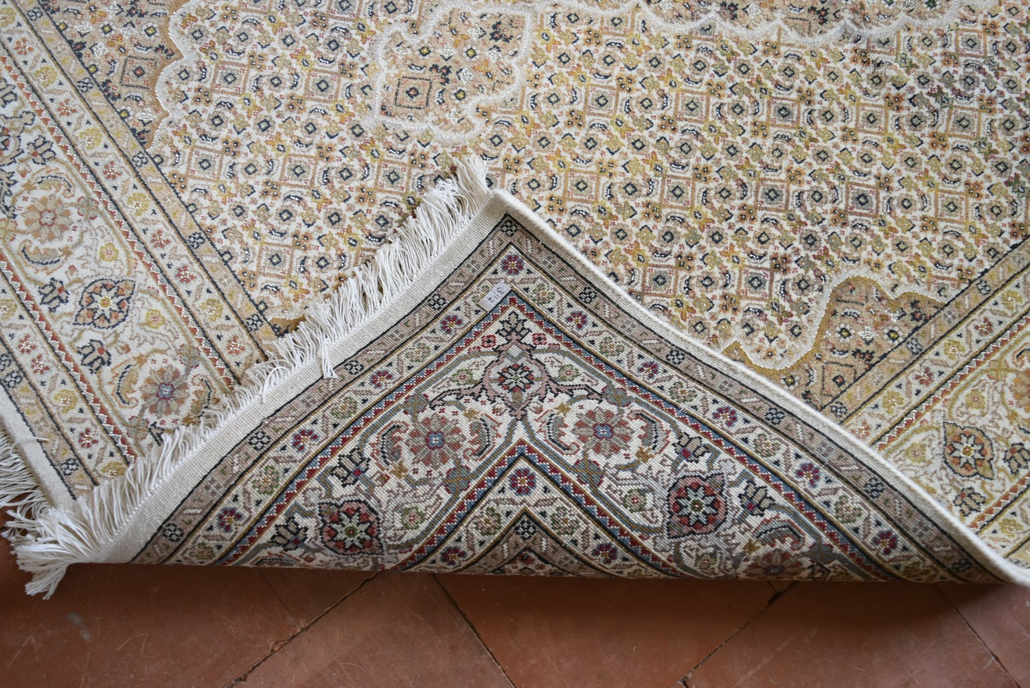 A silk & wool Tabriz style carpet with central medallion and repeating floral design across the fawn - Image 4 of 4