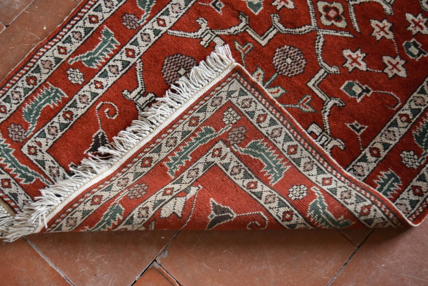 A Moughal style runner with repeating scrolling trellis central design within a border of serrated - Image 4 of 5