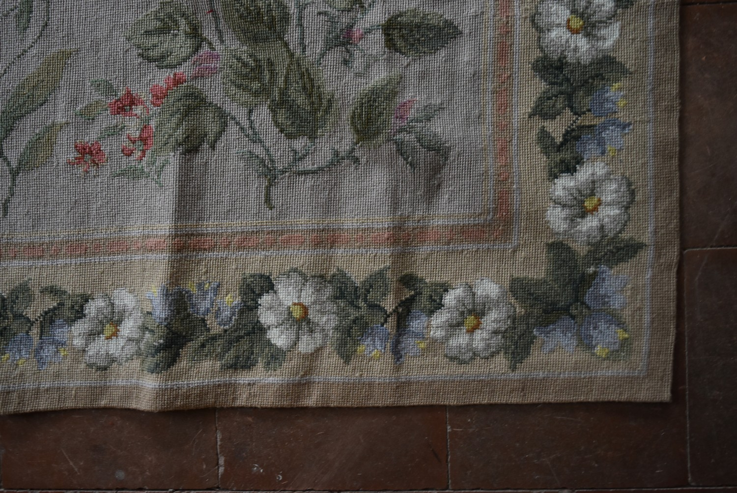 A needlepoint rug with foliate and wild flower sprays across a fawn field contained by garlands of - Image 3 of 4