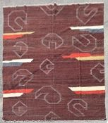 A modern Kilim with abstract design on deep burgundy ground. L.296xW.250cm