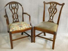 A Georgian mahogany Hepplewhite style open armchair with bird and flower tapestry drop in seat (