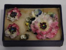 A Royal Crown Derby hand painted porcelain flower brooch and earring suite. Earrings have clip