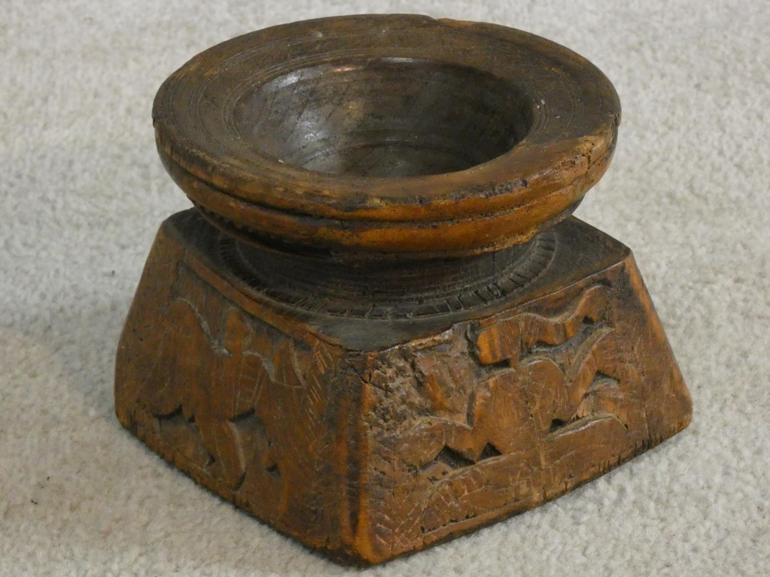 An antique Indian hardwood seed sowing tool with carved detailing of animals and people. H.13 W.17 - Image 2 of 8