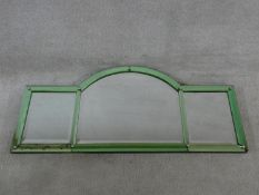 An Art Deco triptych mantel mirror with arched central plate flanked by rectangular plates in pale