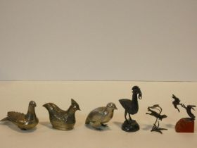 A collection of three Indian silver bird figures, a bronze figure group of fighting hares, a similar