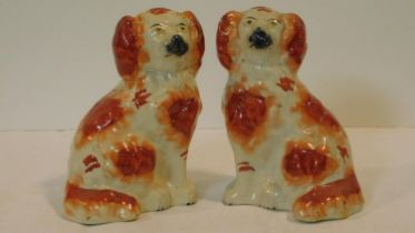 A pair of antique Staffordshire style dogs with hand painted detailing. H.19cm