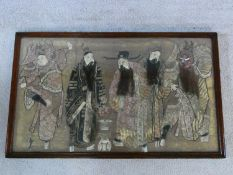 An early 20th century oak framed and glazed Chinese silk embroidery of noblemen and their attendants