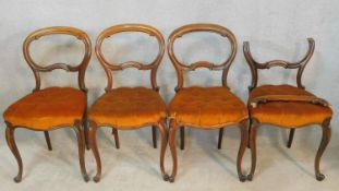 A set of four 19th century rosewood balloon back dining chairs on carved cabriole supports. H.86cm