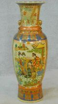 A large ceramic painted and transfer design Oriental vase with gilded lion's head ring handles.