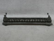 A 19th century cast iron fire kerb with pierced decoration resting on half roundel feet. H.15xW.