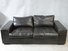 A vintage style Collins & Hayes brown leather upholstered two seater sofa. H.70 W.202 D.100cm