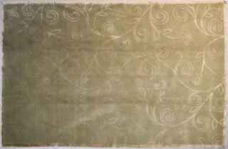 A silk and wool rug with allover scrolling foliate and flowerhead design on a taupe background. L.