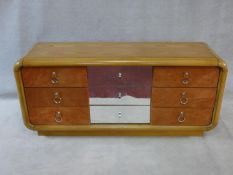 A 1970's vintage mirrored and teak chest in the Art Deco style fitted with nine drawers. H.76xW.