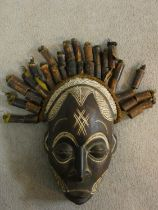 A carved and painted Chokwe Mwano Pwo face mask with tassled headdress, from Angola. 31x18cm