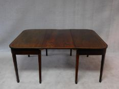 A late Georgian mahogany and satinwood strung D end dining table on square tapering supports and