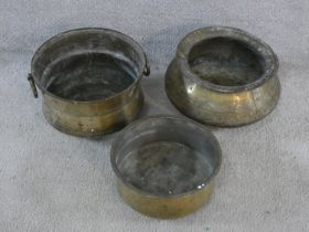 Three vintage hammered brass Indian Handis (cooking pots). One with hinged circular handles and
