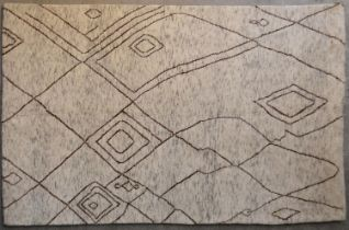 A Moroccan rug with abstract linear design on a pale flecked ivory ground. L.237x152cm