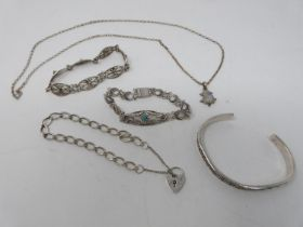 A collection of silver jewellery. Including a silver charm bracelet with heart padlock, a rainbow